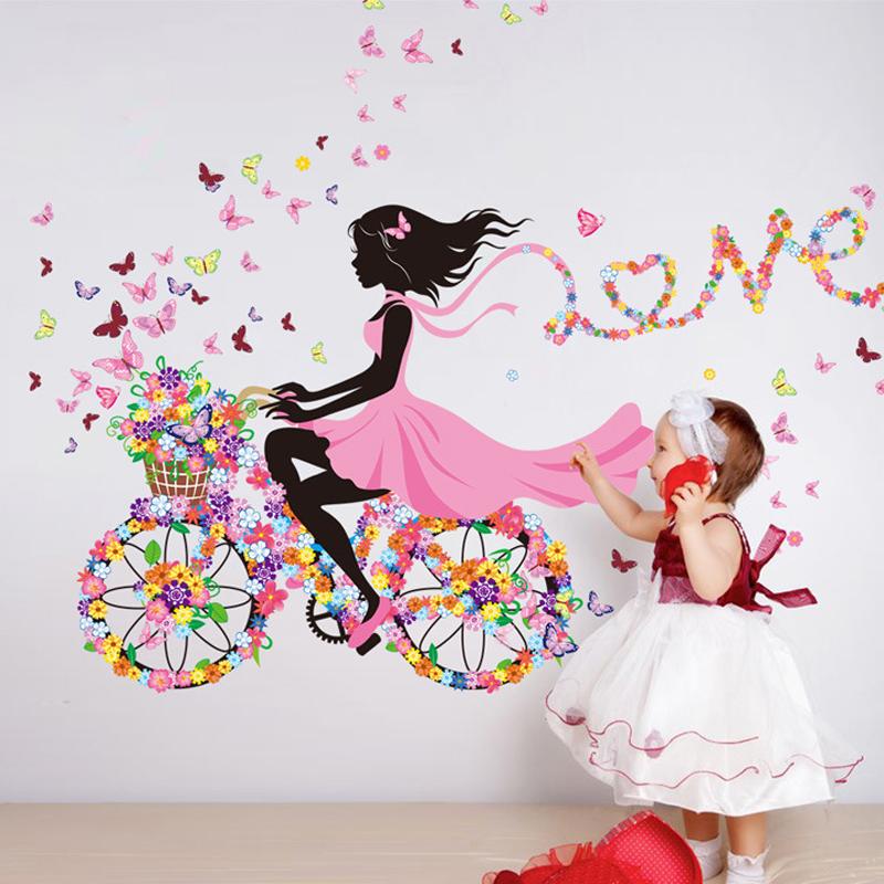 Dívka s kvìtinami na kole
